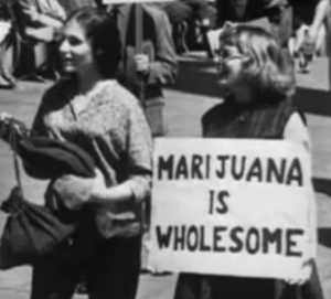 Photo of two women with a sign reading